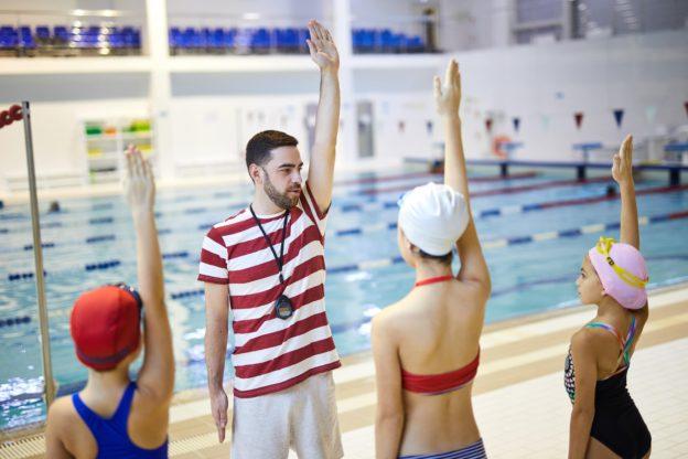 Swim-instructor-training-his-class